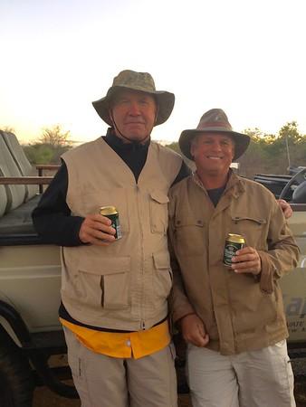 Two men enjoying an evening beer while on safari !