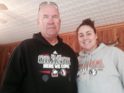 Two former Huskies wearing their sweatshirts from the Huskies playing in the Orange Bowl...