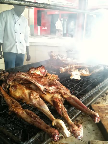 Our dinner a waits - Goat road side Kenya