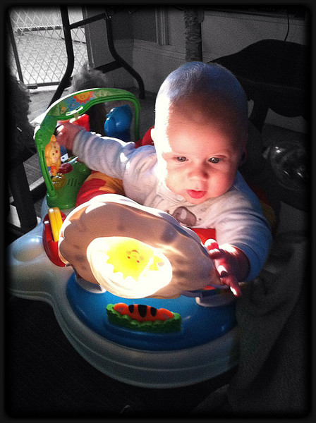 ~ Archiving the Sun ~ The morning light filtering in through the laundry room front door filled Kyler's bouncer Sun bubble with a bright white light. There's a small smiling sun in that bubble that spins. There's no exposure or contrast adjustments here- the light made the toy glow like it really was a little archived piece of happy sun.