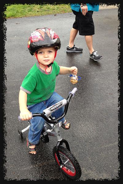 Two Years Eleven. Cookies. Biking in the rain; walking dogs, he rides.