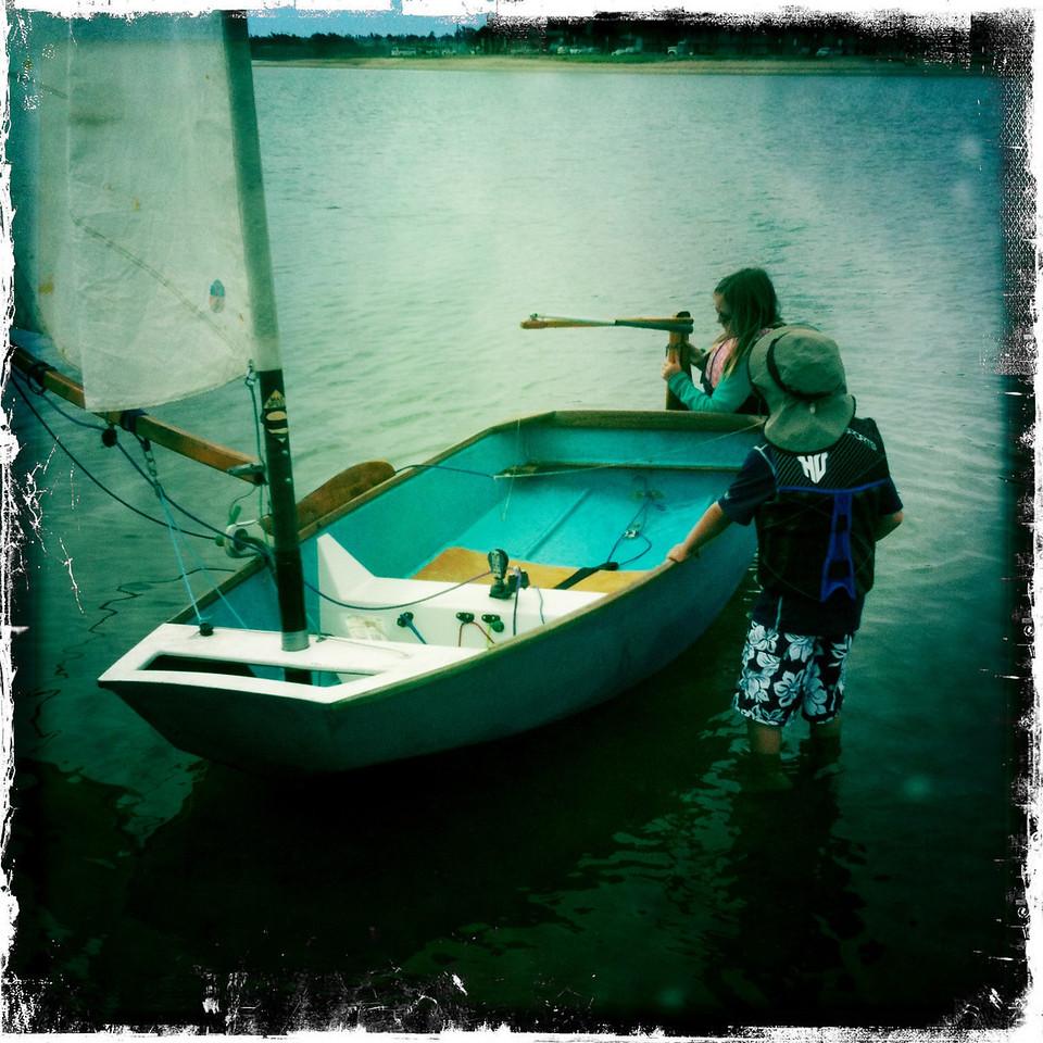 Sabot sailing, launching the boat.