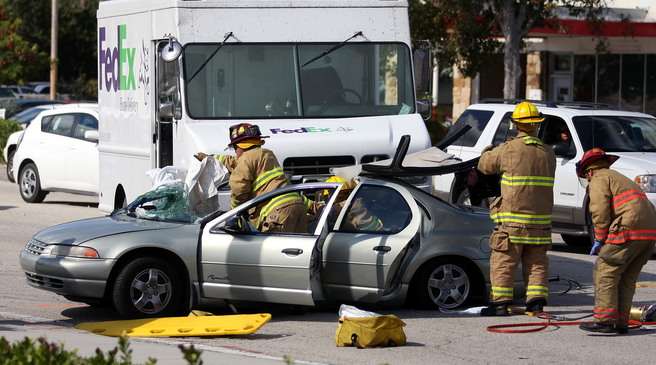 Indian River Fire Rescue remove the top of a four door Plymouth to extricate a female occupant after being struck on the passenger side by a Fed Ex van around 1:00 Pm Tuesday at the intersection of 21st and 10th ave in Vero.