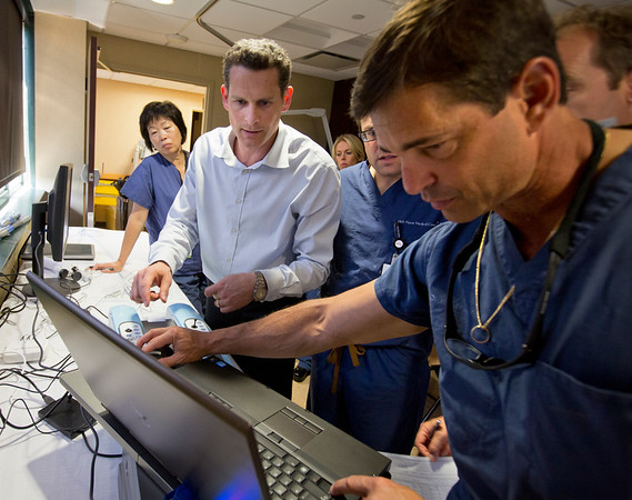 Simbionix employees Erez Ben-Zvi (plaid shirt) and Guy Greller (striped shirt) were on hand at Holy Name Medical Center Interventional Radiology Department to demonstrate a simulated surgery to the doctors in the I.R. department at Holy Name Medical Center in Teaneck, NJ.  6/17/13  Photo by Jeff Rhode/Holy Name Medical Center