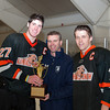 Kimball Union captains Doyle Somerby (KU - 27) and  Alex Carle (KU - 18) accept the 2012 Flood-Marr Toournament trophy.  Kimball Union Boys Varsity Hockey defeated Westminster 4-1 to win the 2012 Flood-Marr Tournament on December 16, 2012, at Noble & Greenough in Dedham, Massachusetts.