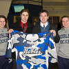 Matthew Harlow (Nobles - 9), Andrew Doane (Nobles - 19), Taylor Blake (Nobles - 35), Michelle Picard (Nobles - 20) - Wearing their third jersey in honor of the the fundraiser for the the Massachusetts Soldiers Legacy Fund, Nobles Girls Varsity defeated Exeter 1-0 on January 22, 2010, at Flood Rink in Dedham, Massachusetts.