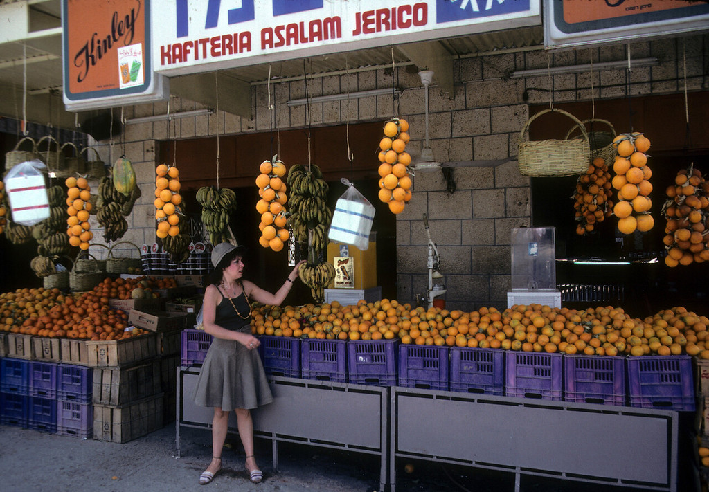 Tory at a fruit stand in Jerico.