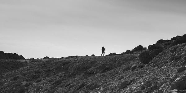 Hiker walking in desert, En Gedi Nature Reserve, Judean Desert, Dead Sea Region, Israel