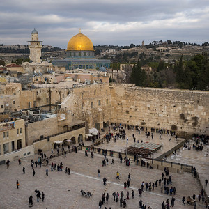 People at the Wailing Wall with dome of the rock in background, Old City, Jerusalem, Israel