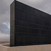 Black wall that symbolizes the Sons of Darkness in the Shrine of Book, Israel Museum, Jerusalem, Israel