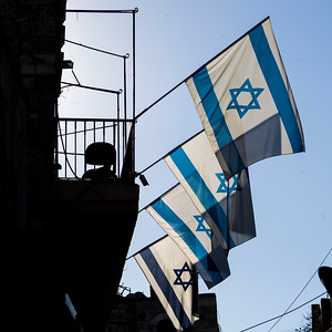 Low angle view of Israeli Flags on building in the Old City of Jerusalem, Israel