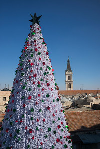Decorated Christmas tree with tower of the San Salvador monastery in the background, Old City, East Jerusalem, Israel