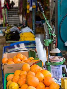 Close-up of orange juice stall in market, Safed, Northern District, Israel