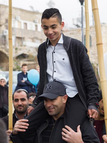Teenage boy on shoulders of his father at Bar Mitzvah Celebration, Safed, Northern District, Israel