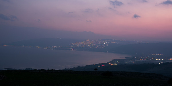 City at coast lit up at dusk, Vered HaGalil, Sea of Galilee, Galilee, Israel