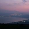 City at coast lit up at dusk, Vered HaGalil, Sea of Galilee, Galilee, Israel