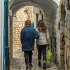 Two women walking through archway, Safed, Northern District, Israel