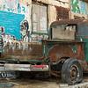 Abandoned vehicle parked outside old building, Florentin, Tel Aviv, Israel