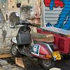 Motor scooter parked outside old building, Florentin, Tel Aviv, Israel