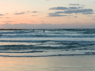 Tourists paddleboarding in the sea, Tel Aviv, Israel