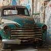Abandoned car parked outside old building, Florentin, Tel Aviv, Israel