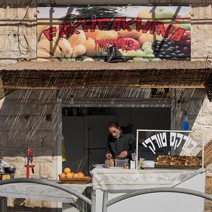 Man selling food at market, Haifa, Haifa District, Israel