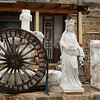 Statues and Wagon wheel outside building, Acre, Israel