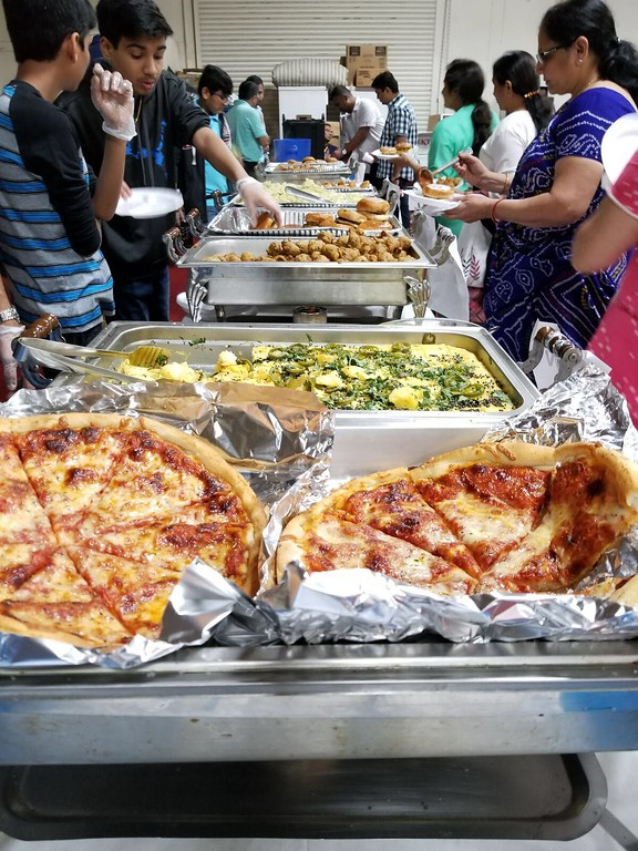 . A variety of foods made fresh by ISSO temple to celebrate the occasion. Traditional Indian, pizza for the kids, indian sweets, ice cream all served. Attachments area