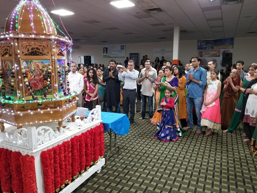 . Friends and family offering prayer during this auspicious occasion.