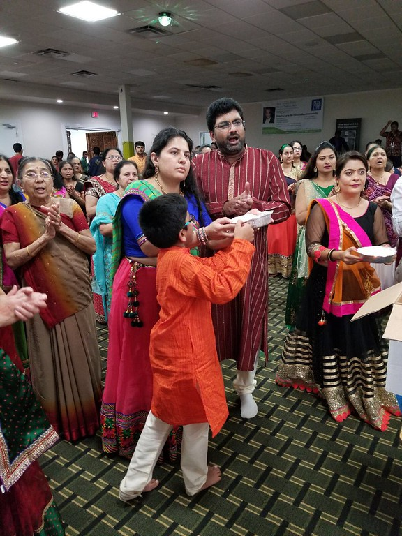 . Parents educating their children on the importance of this beautiful festival. Here are Hemant & Dr. Hiral Patel.