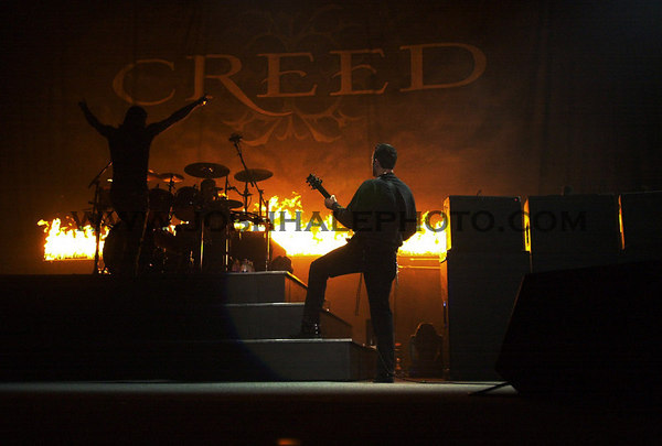Josh Hale/Iowa State Daily<br /> Creed singer Stapp is siloeted by fire that lit up the crowd during their first song, while guitarist Mark Tremonti plays on the side.  Creed ignited the sold out crowd Friday night in Hilton.  (3-24-00)