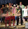 Josh Hale/Iowa State Daily<br /> Gallagher smacks his trademark watermellon with and enlarged version of Sledge-O-Matic for a plastic clad crowd at Stevens Auditorium on Saturday evening.  Gallagher mixed his truthfull views on life with sexual sarcasm and came out smashing everything from mustard to eggs mixed with marshmellows.  (9-9-00)