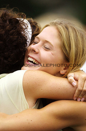 Josh Hale/Iowa State Daily<br /> Jill Tiemeyer, right freshmen undecided, hugs Ann Kiely, freshmen in pre-business, after being accepted into the Ki Omega Sorority Thursday afternoon on central campus.  (8-17-00)