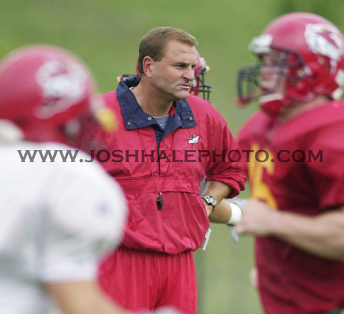Josh Hale/Iowa State Daily<br /> Coach Dan McCarney watches as his player warm up before practice on Monday afternoon at the ISU Football practice field.  (8-28-00)