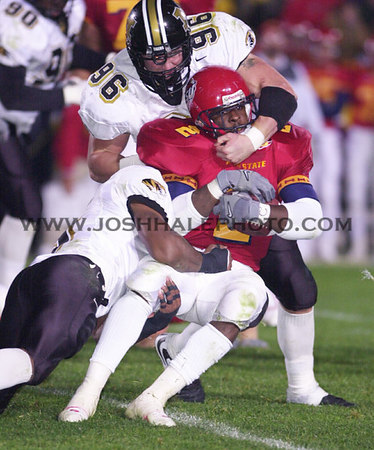 Josh Hale/Iowa State Daily<br /> Ennis Haywood is taken down with face masking by Missouri's Justin Smith during the 39-20 Cyclone victory on Saturday evening at Jack Trice.  (10-28-00)