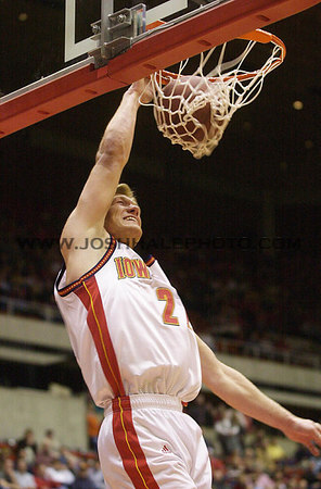 Josh Hale/Iowa State Daily<br /> Shane Powers throws down a one handed dunk duing the final minuets of Tuesday nights victory of 84-68 over Colorado in Hilton.  (1-16-01)