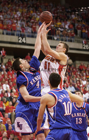 Josh Hale/Iowa State Daily<br /> Martin Rancik tries for a shot over Nick Collison of Kansas duing the men's basketball game on Saturday afternoon in Hilton where the Cyclones finished with a win of 79-71.  (2-17-01)