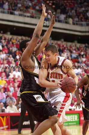 Josh Hale/Iowa State Daily<br /> Martin Rancik drive through a Missouri player duing the Men's victory on 72-64 on Sunday afternoon in Hilton.  (2-11-01)