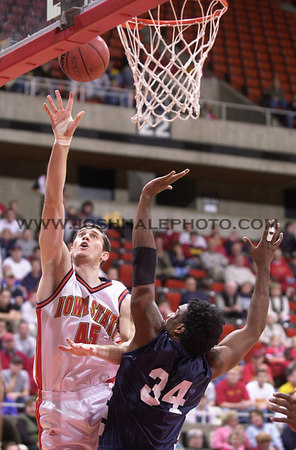 Josh Hale/Iowa State Daily<br /> Paul Shirley goes up for the shot against Sharif Fajardo for Next Level Sports on Wednesday evening in Hilton for the men's basketball game.  (11-8-00)