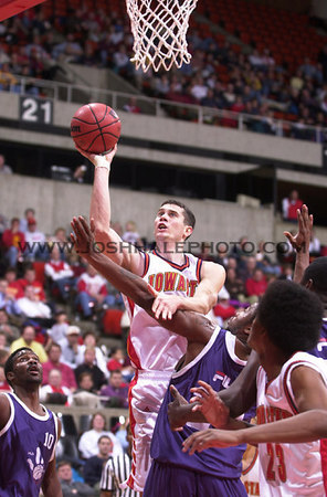 Josh Hale/Iowa State Daily<br /> Paul Shirley goes up for the shot against Global Sports on Wednesday evening during the men's exhibition game which ended in a 91-85 Cyclone victory in Hilton.  (11-15-00)
