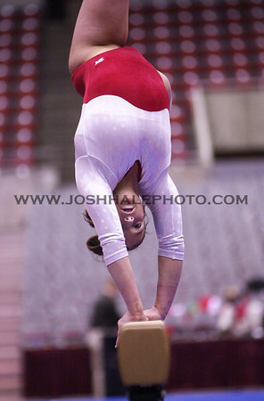 Josh Hale/Iowa State Daily<br /> Jessy Smith performs on beam duing the gymnastics meet on Friday in Hilton against Minnesota and Oklahoma.  (2-16-01)