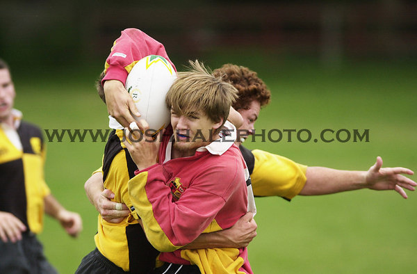 Josh Hale/Iowa State Daily<br /> Jason York battles with an Iowa player during the Iowa State vs. Iowa Rugby game on Saturday at the Rugby Field south of Towers.  (9-15-01)