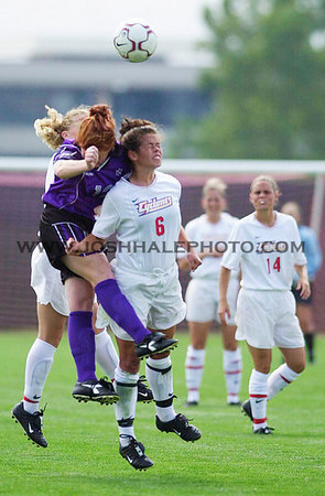 Josh Hale/Iowa State Daily<br /> Laura Schweer goes up aginst some UNI players during the women's soccer 1-0 victory on Sunday at the ISU Soccer Field.  (9-03-01)
