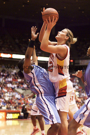 Josh Hale/Iowa State Daily<br /> Angie Welle goes of the the shot while pussing against a North Carolina defender Sunday afternoon during the women's game.