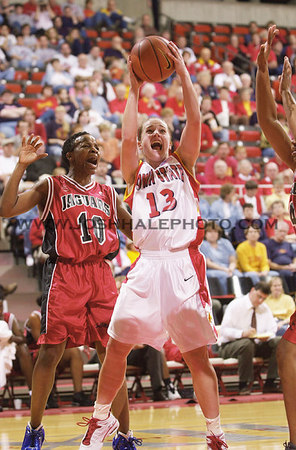 Josh Hale/Iowa State Daily<br /> Lindsey Wilson (13) drives in for a shot against Houston Jaguar Rasheeda Clark (10) during the Women's Basketball Exhibition on Sunday afternoon in Hilton.  (11-4-01)