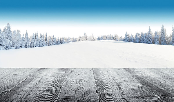 Winter snowy landscape with wooden planks