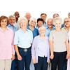 Mob of senior citizens smiling on white background