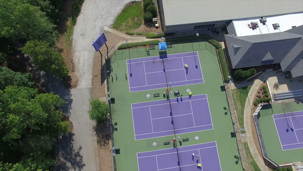 Aerial flying over outdoors tennis sports park