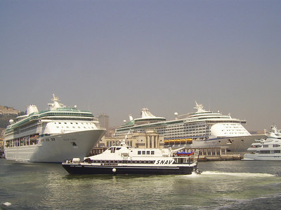 2007 - HSC SNAV AURORA maneuvering in Napoli, between LEGEND OF THE SEAS and VOYAGER OF THE SEAS.