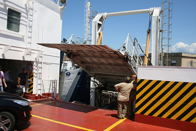 2010 - Crossing the Strait of Messina on board trainferry SCILLA. Lowering side gangway.